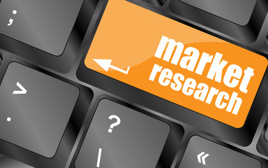 key with market research text on laptop keyboard, business