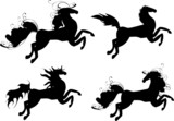 Four black horses - symbol of 2014 year