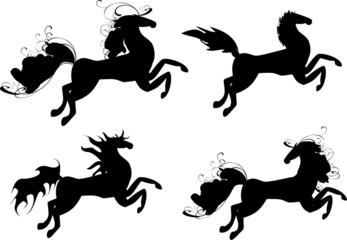 Four black horses - symbol of 2014 year