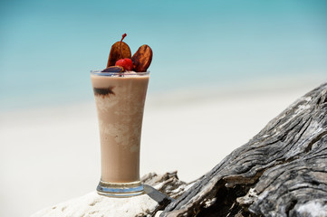 tropical drink at sandy beach on the ocean