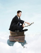 businessman sitting on suitcase