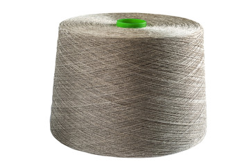Linen natural yarn bobbin isolated on white background