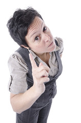 angry woman wearing suit and pointing finger with copy space