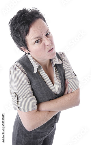 angry woman wearing suit and crossing arms with copy space