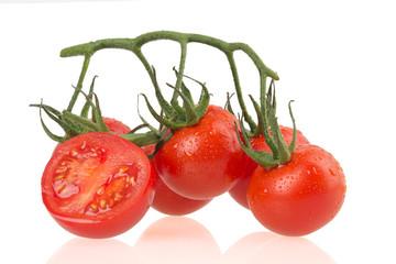 Ripe tomatus on white background