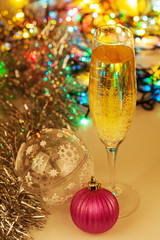 Glass of champagne and christmas decorations on new year backgro