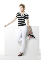 Full body pretty young woman in stripy shirt posing