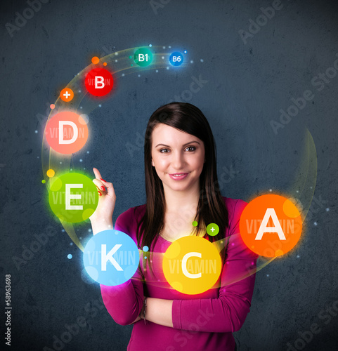 Young woman thinking with vitamins circulation around her head