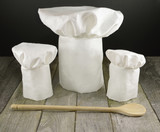 Three chef's toques and spoon