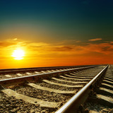 orange sunset over railroad