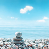 zen-like stones on beach. soft focus