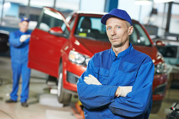 Repairman auto mechanic at workshop