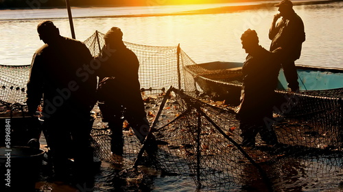 Fishermen at sunset