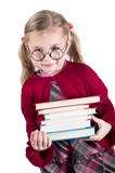 ittle girl wearing spectacles holds books close up