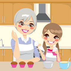 Grandmother Teaching Granddaughter in Kitchen