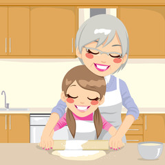Grandmother Teaching Granddaughter Make Pizza