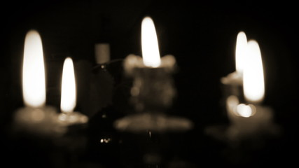 Candles in candelabrum with five branches in full dark