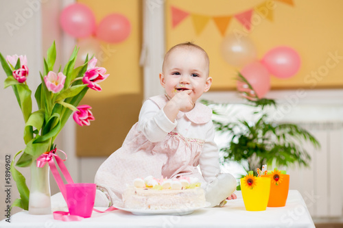 baby girl eating cake