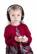 Little blonde girl smiling listening to music on smart phone