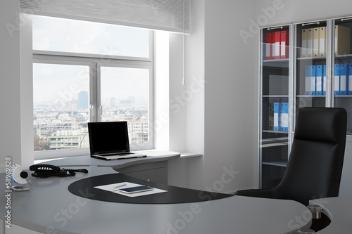 Office with urban view through window