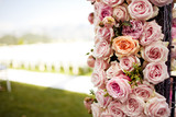 Pink roses and peonies wedding arch