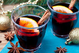 Mulled wine and spices with christmas decorations
