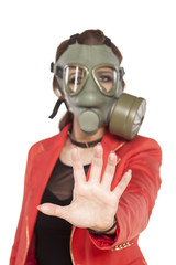 young business woman with a gas mask showing stop sign