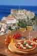 Leinwandbild Motiv Scilla castle with pizza and vine in Calabria, Italy