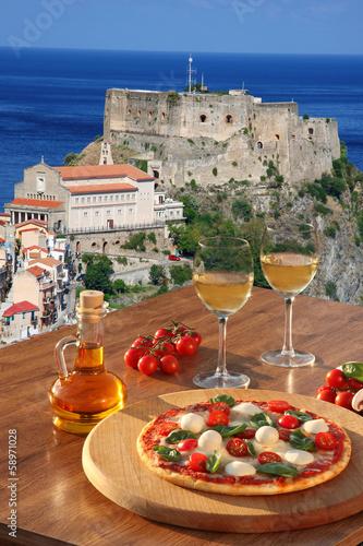 Scilla castle with pizza and vine in Calabria, Italy - 58971028