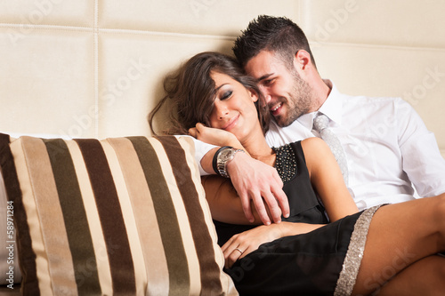 Happy young couple relaxing in hotel room.