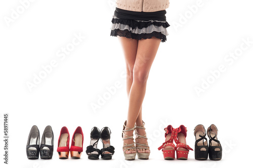 Sexy young woman legs with different kind of shoes on white back