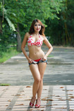 Young beautiful Asian woman in red bikini with short pants