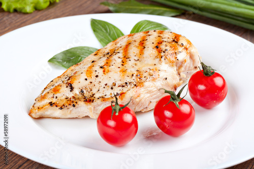 Grilled chicken breast with fresh cherry tomatoes