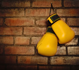 Pair of yellow boxing gloves