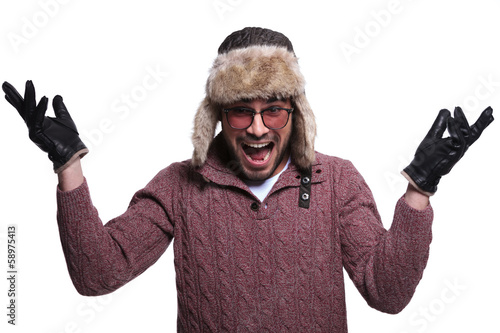 man in fur hat and winter clother is being very surprised and sc