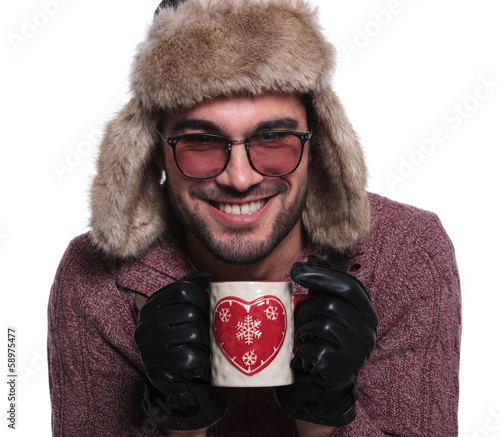 laughing man holding mug