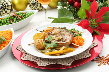 christmas table with pork medallion dish