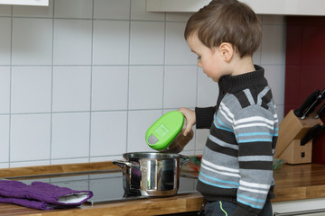 Child coocking in a kitchen