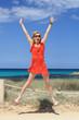 cheerful girl jumping on the beach