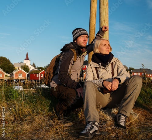 Young travellers couple in Reine village, Norway