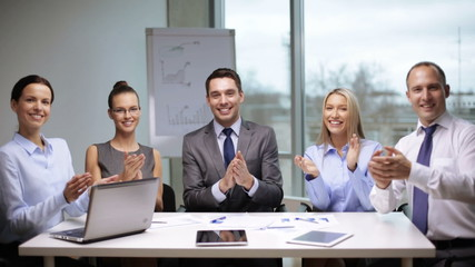business people applauding on meeting