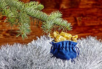 Christmas decorations. Blue sack with christmas presents, fir-tr