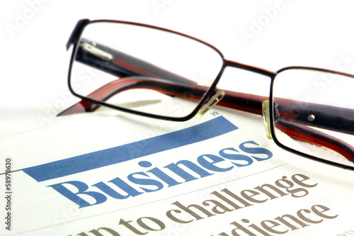 eyeglasses on a business papers