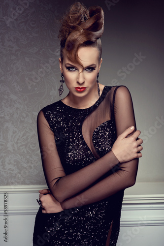 beautiful blonde woman with creative hairstyle and evening dress