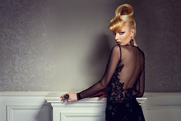 beautiful blonde with creative hairstyle wearing evening dress