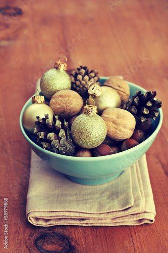 Christmas decoration with nuts, cones, Christmas balls