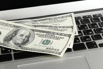 Money on laptop close-up