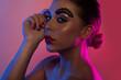 Profile beauty portrait of a woman in pink light