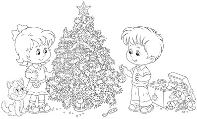 Little girl and boy decorate their Christmas tree