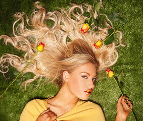 Seductive blond with her hair covered in roses